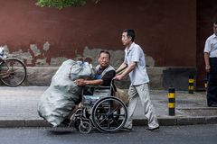 Scavengers with disabilities in a International city Stock Photos
