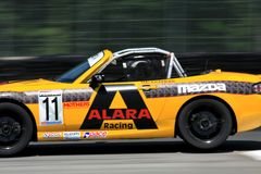 SCCA Playboy Mazda MX-5 Cup. Ara Malkhassian races the Mazda MX-5 on the track for ALARA Racing team at the Pro Playboy Mazda MX-5 Cup, professional motorsports Stock Photo