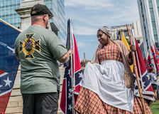 SCConfederateFlagRally. Columbia, South Carolina - July, 10, 2017: Celebrity Black Confederacy supporter Arlene Barnum, of Stuart, Oklahoma talks to a fellow Royalty Free Stock Photo
