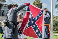 SCConfederateFlagRally. Columbia, South Carolina - July, 10, 2017: Celebrity Black Confederacy supporter Arlene Barnum of Stuart, Oklahoma watches as Confederate Royalty Free Stock Images
