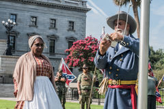 SCConfederateFlagRally. Columbia, South Carolina - July, 10, 2017: Celebrity Black Confederacy supporter Arlene Barnum of Stuart, Oklahoma watches as Confederate Stock Photography