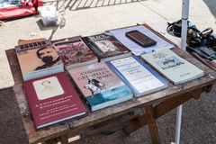 SCConfederateFlagRally. Columbia, South Carolina - July, 10, 2017: Confederacy literature sits on a table under a tent during the Confederate flag raising event Royalty Free Stock Photo