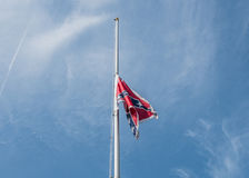 SCConfederateFlagRally. Columbia, South Carolina - July, 10, 2017:A Confederate flag makes its way up a portable flag pole during the Confederate flag raising Stock Photo
