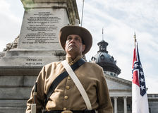 SCConfederateFlagRally. Columbia, South Carolina - July, 10, 2017: A Confederate reenactor stands post in front of the Confederate Memorial Monument on the South Stock Photography