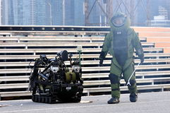 SCDF CBRE personnel diffusing bomb with robot. Singapore Civil Defence Force (SCDF) Chemical-biological-radiological-explosives (CBRE) personnel diffusing bomb Royalty Free Stock Photo
