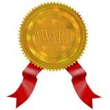 Sceau d'or avec la récompense rouge de bande Photo stock