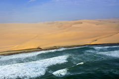 The sceleton coast in Namibia. Aerial view on the shipwreck on the Sceleton coast in Namibia where dunes of the Namib desert meet with Atlantic ocean, Africa Stock Photo