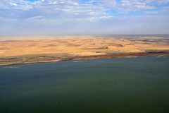 The sceleton coast in Namibia. Aerial view on the Sceleton coast in Namibia where dunes of the Namib desert meet with Atlantic ocean, Africa stock photography