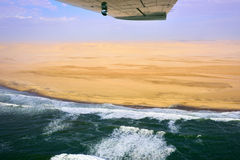 The Sceleton coast in Namibia. Flight over the Sceleton coast in Namibia where dunes of the Namib desert meet with Atlantic ocean, Africa royalty free stock photography