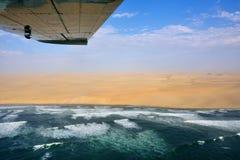 The Sceleton coast in Namibia. Flight over the Sceleton coast in Namibia where dunes of the Namib desert meet with Atlantic ocean, Africa stock images