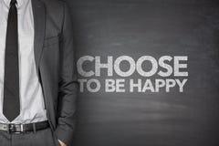 Scelga di essere felice sulla lavagna immagine stock