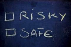Scelte: rischio contro sicurezza Fotografie Stock