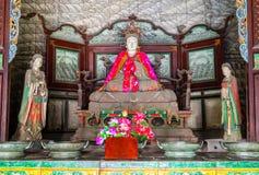 Scena commemorativa del tempio di Jinci (museo). La madre da santo e le domestiche hanno colorato la scultura di argilla al corrid Fotografia Stock