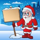 Scena con il Babbo Natale e la scheda Fotografie Stock Libere da Diritti