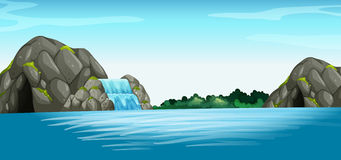 Scena con la cascata e la caverna Fotografie Stock