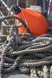 Scena del porto con la corda e la boa arancio Fotografia Stock Libera da Diritti