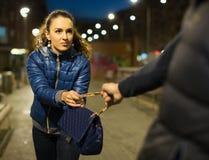 Scena di furto della via di notte Immagini Stock