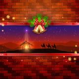 Scena di Natale sul fondo del muro di mattoni con le campane e l'arco Immagini Stock