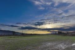 Scena di tramonto del paesaggio del campo Fotografie Stock