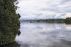 Scena pacifica di pesca sul lago di Menteith Fotografie Stock