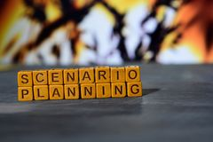 Scenario planning on wooden blocks. Cross processed image with bokeh background royalty free stock images