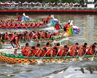 Scene from the 2012 Dragon Boat. KAOHSIUNG, TAIWAN - JUNE 23: Four unidentified teams compete in the 2012 Dragon Boat Races on the Love River on June 23, 2012 in Royalty Free Stock Photos