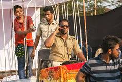 Scene with actors in policemen uniform playing corruption police department at traditional Goa carnival stock images