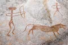 A scene of animal hunting performed ocher on the wall of the cave. Ancient people. stone Age. archeology Royalty Free Stock Images