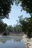 View of the island temple Preah Neak Pean. Scene around the Angkor Archaeological Park. The site contains the remains of the different capitals of the Khmer Royalty Free Stock Images