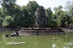 View of the island temple of Preah Neak Poan. Scene around the Angkor Archaeological Park. The site contains the remains of the different capitals of the Khmer Stock Photography