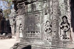 Carvings on the walls of a building in the 12th Century Ta Som temple complex. Scene around the Angkor Archaeological Park. The site contains the remains of the Stock Photos