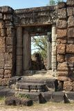 Doorway with carved lintel at the 10th Century East Mebon temple. Scene around the Angkor Archaeological Park. The site contains the remains of the different Royalty Free Stock Photo