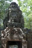 Eastern entrance carved with four faces  to the 12th Century Ta Som. Scene around the Angkor Archaeological Park. The site contains the remains of the different Royalty Free Stock Images