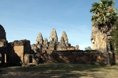 View of Pre Rup a 10th century hindu temple from road. Scene around the Angkor Archaeological Park. The site contains the remains of the different capitals of Stock Photos