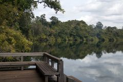 View of Yeak Lom lake from wooden pier stock photography
