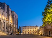 Papal Palace square, Avignon. Scene around Papal Palace square in Avignon, France, under twilight evening sky stock images