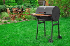 Scene Of Barbecue Grill Party On Lawn In The Backyard. Scene Of Family Barbecue Grill Party Or Picnic On The Lawn In The Backyard At Summertime Weekend Stock Image