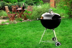 Scene Of Barbecue Grill Party On Lawn In The Backyard. Scene Of Family Barbecue Grill Party Or Picnic On The Lawn In The Backyard At Summertime Weekend Royalty Free Stock Image