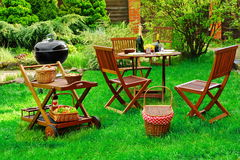 Scene Of Barbecue Grill Party On Lawn In The Backyard. Scene Of Family Barbecue Grill Party Or Picnic On The Lawn In The Backyard At Summertime Weekend Stock Photo