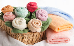 Scene with bath towels. Cosy scene with towels in the form of flowers Stock Photos