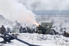 Scene of battle during military-historical festival. Ulyanovsk, Russia - February 25, 2017:  Scene of battle  during reenactment of World War II battle. Military Stock Photo