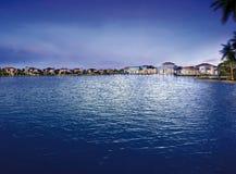 Big blue lake in luxury village. Stock Photo