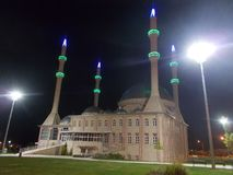 A Big Mosque, Captured Night Time. A scene of a big mosque with 4 minarets, captured at night time. Green grass on environment royalty free stock photos