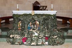 The scene of the birth of the Son of God in the St. Joseph`s Church in the old city of Nazareth in Israel. Nazareth, Israel, December 23, 2017 : The scene of the Royalty Free Stock Image