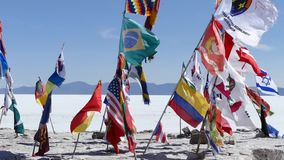 Bolivia salt flats flags. Scene from Boliva South America Slow  Motion of salt flats flags flapping in the wind stock video