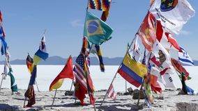 Bolivia Salt flats Flags 2.mp4. Scene from Boliva South America Slow  Motion of salt flats flags flapping in the wind stock video footage