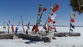 Bolivia Salt flats Flags 3.mp4. Scene from Boliva South America Slow  Motion of salt flats flags flapping in the wind stock footage