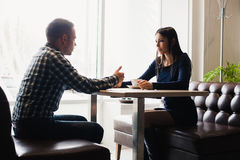 Scene in cafe - couple conflict arguing during the lunch. Royalty Free Stock Photo