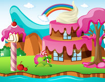 Scene with cakehouse and rainbow Royalty Free Stock Photo