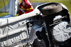 Scene of a car crash and emergency rescue service. In action stock image
